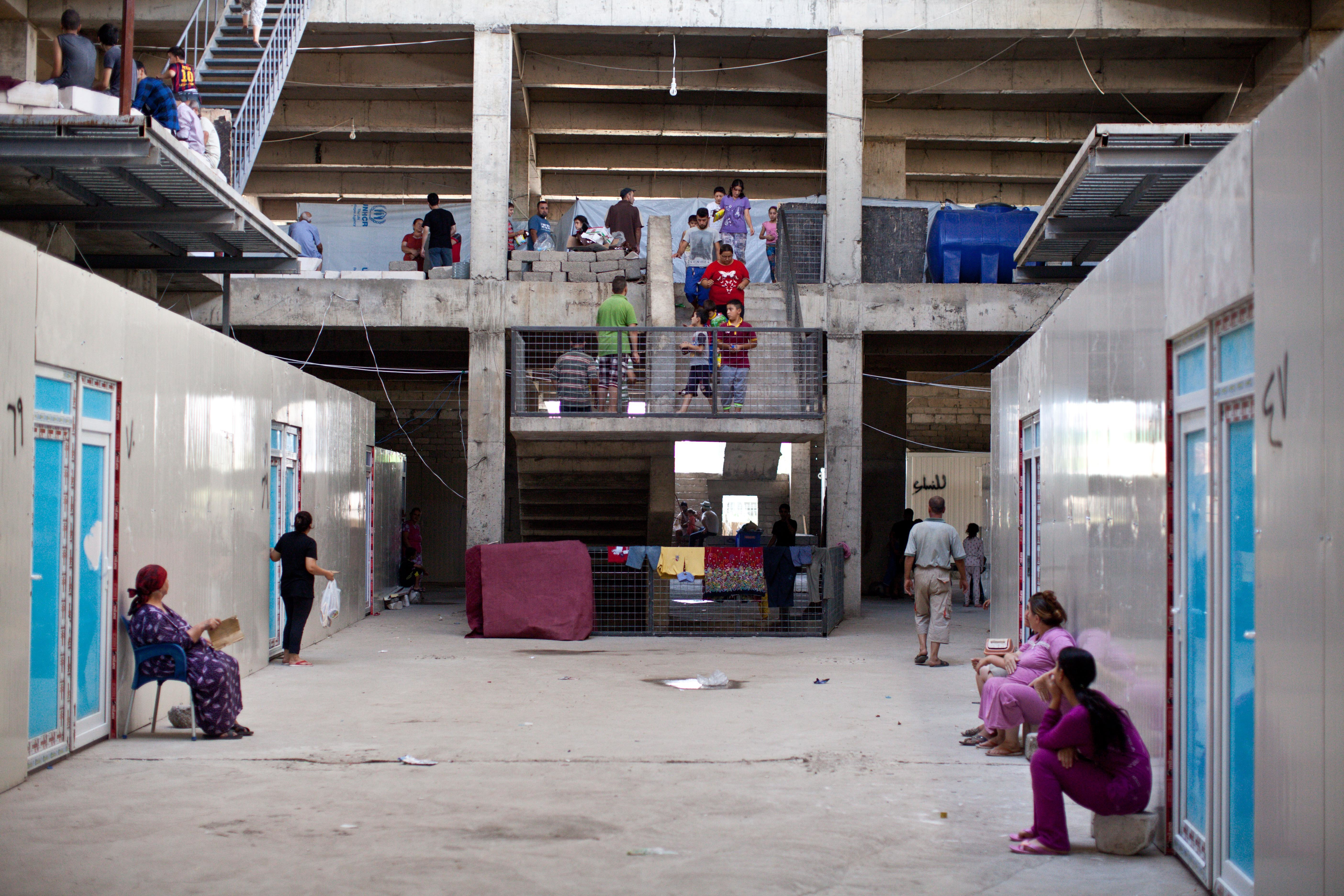 ERBIL, IRAQ: The interior of a building that is now inhabited by displaced Iraqi Christians. Photograph by Sebastian Meyer