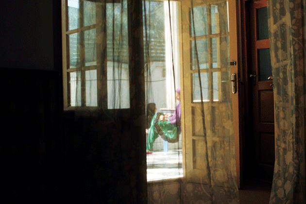 A girl sits in the courtyard of a WAW shelter in Kabul