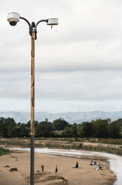 A CESFRONT video camera in the Dominican border city of Dajabón monitors the Río Masacre, which separates Haiti and the D.R. Photograph by Thomas Freteur.