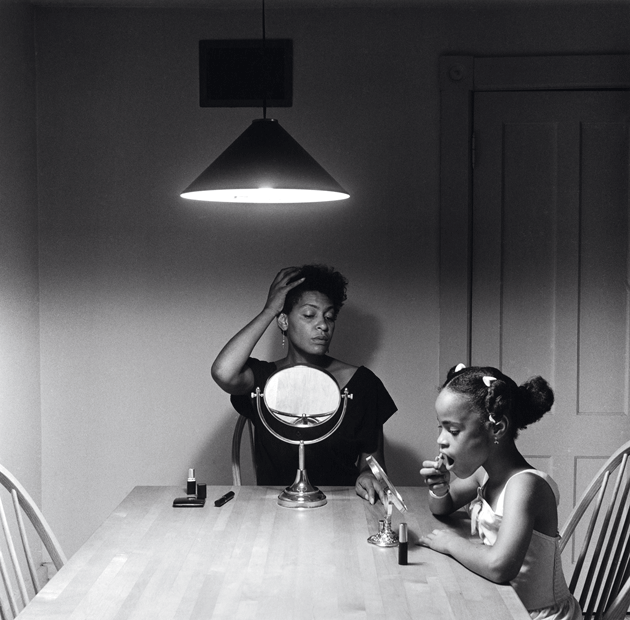 """Untitled (Putting on Make-Up), Kitchen Table series II,"" by Carrie Mae Weems, whose work was on view last year at the Solomon R. Guggenheim Museum, in New York City © The artist. Courtesy the artist and Jack Shainman Gallery, New York City"