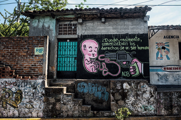 An antiabortion mural on a street off the highway from Chalatenango to San Salvador