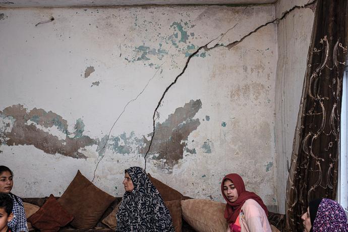 The home of Abu Saleh Aweideh and his family, which they claim has been damaged by tunnel digging. Nine people—two adults and seven children—sleep in a single room. The family believes this room to be the safest in the event of a structural collapse.