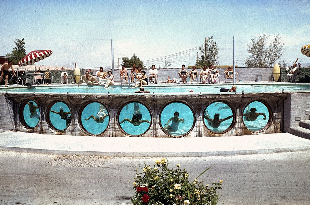 Swimmers look through underwater portholes in a pool in Las Vegas, 1955. Photograph by Loomis Dean, whose work is included in the book The Swimming Pool in Photography, which was published last year by Hatje Cantz.