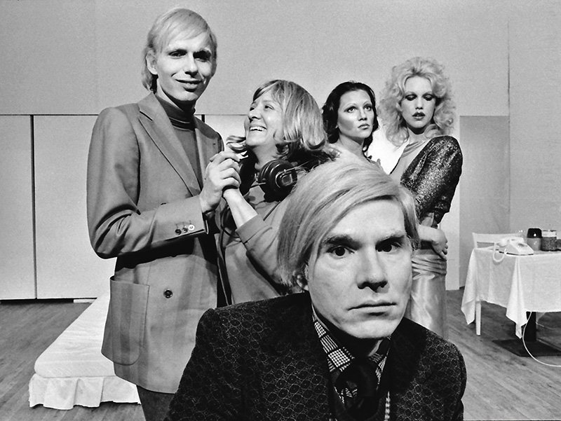 Andy Warhol with the cast of his play Pork, onstage at La MaMa Experimental Theatre Club, New York City, 1971 © Jack Mitchell/Getty Images